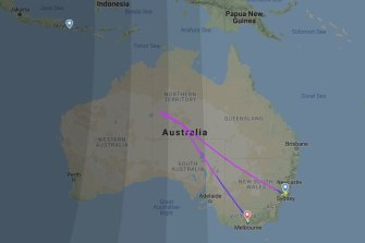 The JQ37 flight from Sydney to Denpasar turned back to land at Melbourne after the pilot noticed a crack in the cockpit windshield.