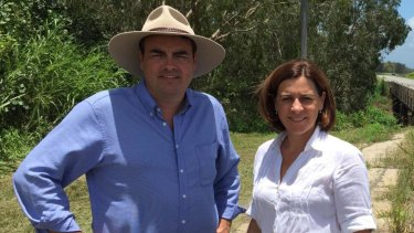 Newly independent MP Jason Costigan, pictured with LNP leader Deb Frecklington, will miss the first sitting week.