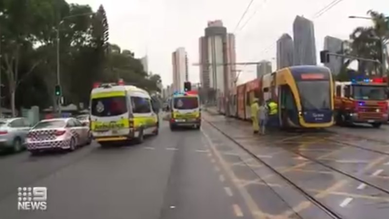 Woman threatened at gunpoint after stolen car slams into Gold Coast tram