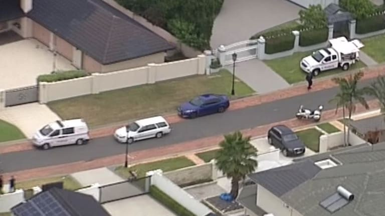 Queensland police were on scene at Paradise Point following the death of a one-year-old boy who was run over by a maxi taxi.