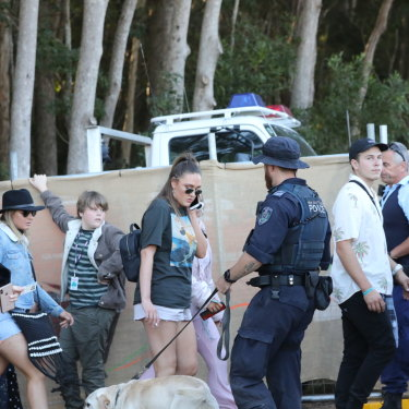 A police sniffer dog checks revellers at a music festival.