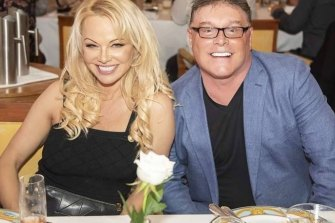 Actress and model Pamela Anderson, pictured here with Mr Buckley, has featured in Ultra Tune's controversial advertising campaigns which have attracted regular complaints to the Advertising Standards Bureau.