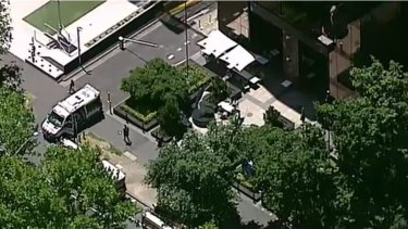 Emergency services at the scene on St Kilda Road, where both the US and Indian consulates are located