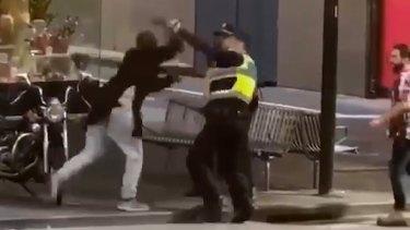 Police confront Shire Ali in BourkeStreet.