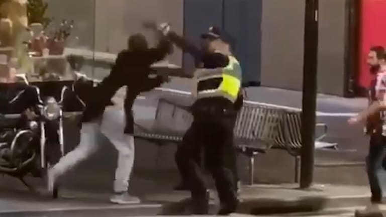 Police confronting Bourke Street attacker Hassan Khalif Shire Ali last Friday.