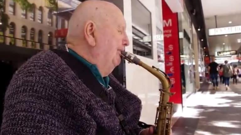 Brisbane's vision-impaired busker 79-year-old Graham Pampling.