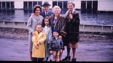 Howard (in yellow coat) with mum Susan, brother Peter, sister Susie and relatives on his mother's side.