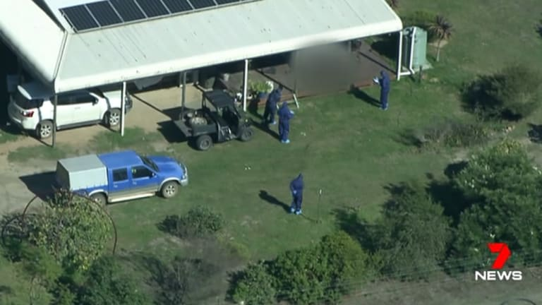 Police said the bodies of two adults were found outside near a shed that had been converted to living quarters.