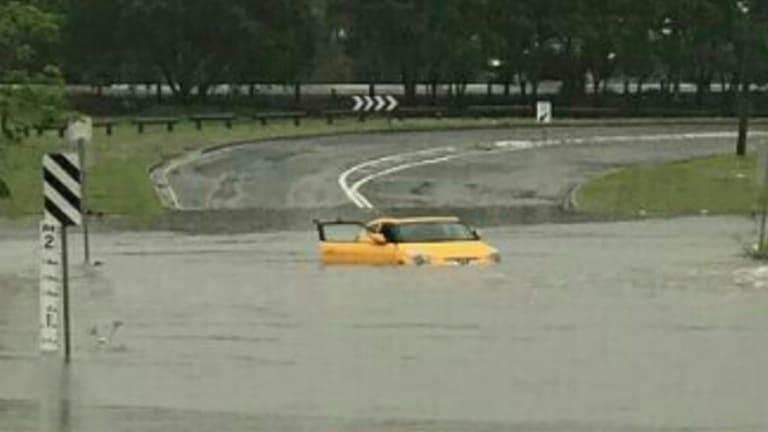 A car trapped in a Rocklea flood.