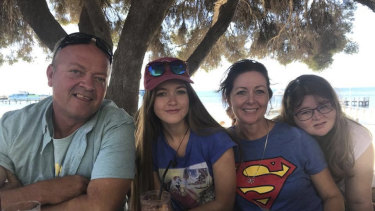 Lisa Gregory with her husband Gary and two daughters Cleo and Baylee at the MND WA annual charity skydive.
