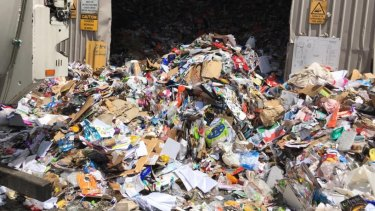 Waste that could have been recycled gushes out of an SKM facility in Melbourne's west.