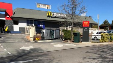 A car has rolled over at Belconnen McDonald's.