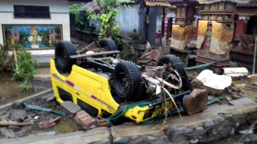 A ruined car that was rolled over after the tsunami hit Sunda Strait.