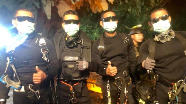 Three Thai Navy SEALs and a Thai doctor stayed with the boys overnight and were the last people out of the cave.