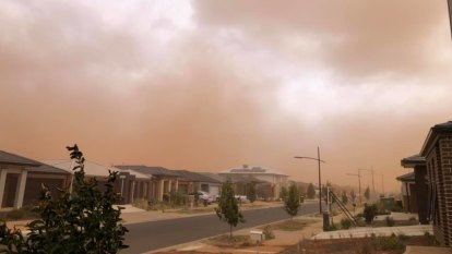 Dust storm rolls through Melbourne, as snow falls at Mount Baw Baw