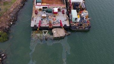 Thepartially raised fishing trawler Dianne at the Port of Bundaberg.