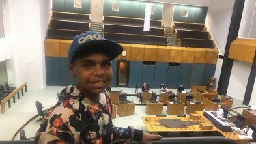 Dujuan Hoosen listens on as his speech is read in Northern Territory Parliament.