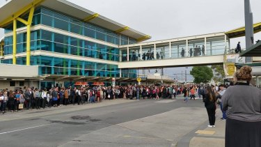 Crowds wait for replacement buses at Dandenong Station after the suspension of Cranbourne and Pakenham lines earlier this year.