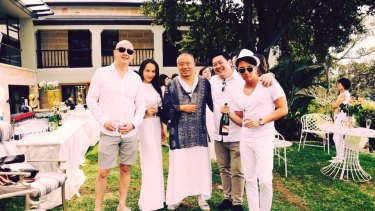 Kuizhang 'Sam' Guo (centre) at his White Party with guests including Sasha Chan (left) and Ryan Gollan (far right).