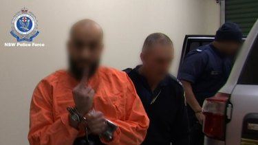 Bassam Hamzy is taken to Goulburn police station and charged with running an ice dealing ring from inside the Supermax.