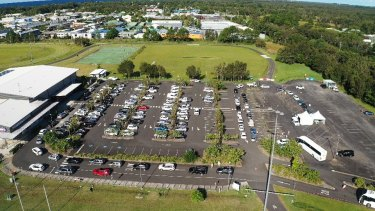 People wait in their parked cars to be tested for COVID-19 at Byron Bay.