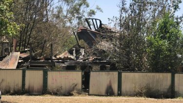 The fire destroyed the house on Woogaroo Street in Goodna and left a man in a serious but stable condition in hospital.