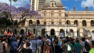People rally outside Parliament in Brisbane to rail against Queensland's proposed anti-protest laws.