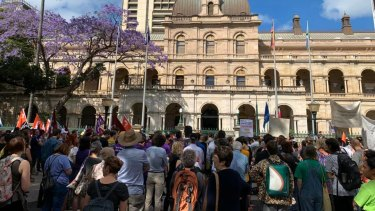 People rally outside Parliament in Brisbane to rail against Queensland's proposed amendments to protest laws.