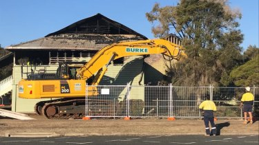 Demolition work on the gutted buildings began on Saturday.