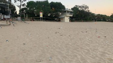 Noosa's Main Beach was littered with rubbish, including broken glass, on Sunday after a Schoolies party the night before.