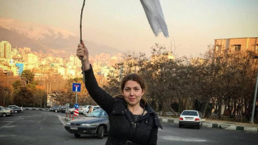 One of the women in Iran protesting by holding their veils aloft on sticks in late 2017 and 2018.