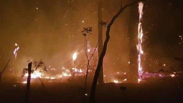 Volunteer firefighter Chloe Hines captured images of fires burning in Carnarvon National Park on Wednesday night.