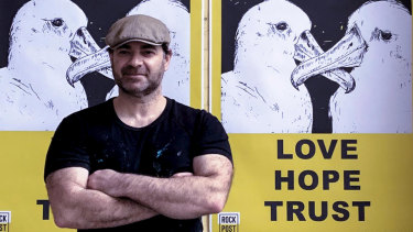 Melbourne artist Marco Luccio with his Love Hope Trust poster.