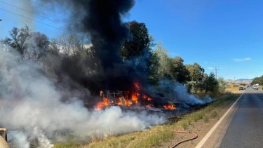 The fiery wreckage of the couple's car and caravan.