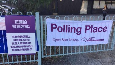 Liberal Party signage outside a polling booth in the Melbourne seat of Chisholm.