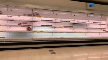 Empty supermarket shelves at Coles in Karratha as residents prepare for the Cyclone Damien.