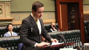 Sebastien Riou speaking in the YMCA Youth Parliament.