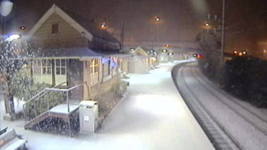 Snow blankets Katoomba train station on Tuesday morning.