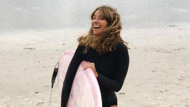 """Courtney Adamo is a """"murfer"""", a mum surfer."""