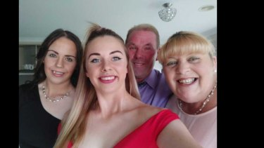 Abbey Forrest (left), her sister, Emily, and their parents Alan and Elizabeth.