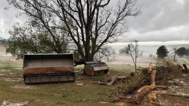 Coolabunia farmer Damien Tessmann is trying to repair the damage after thunderstorms and hail hit the area.