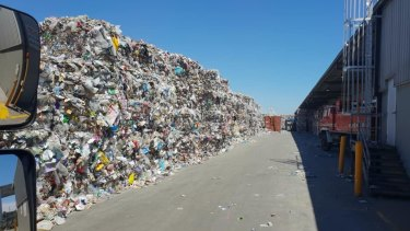 A wall of recycling material, at one of SKM's western Melbourne facilities.
