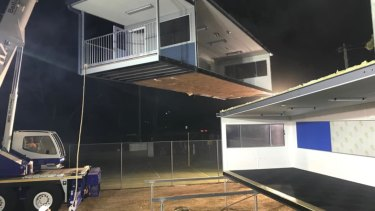 Workers winched in temporary buildings overnight to get the school back up and running by Monday.