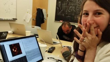 Scientist Katie Bouman after the first image of a black hole takes shape.