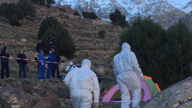 A forensic team attends the site where two Scandinavian women were found near Imlil in the High Atlas mountains, Morocco.