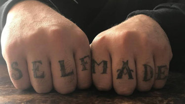 "Sam Karagiotis has ""self made"" tattooed across his knuckles."