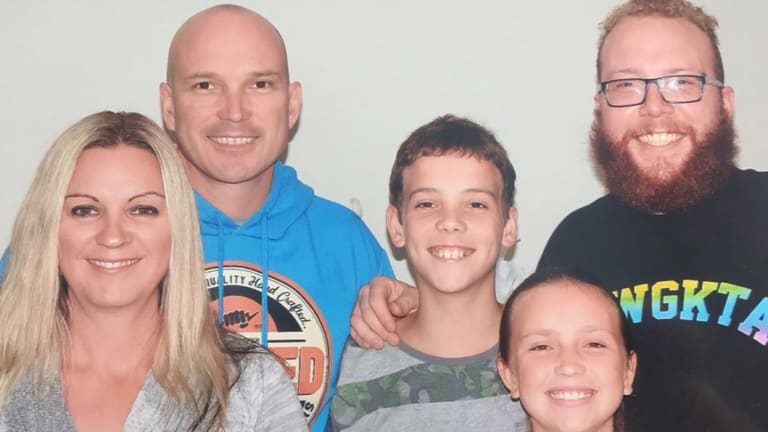 Scott Blanchard, left, in the blue top, with his three children and wife Justine.
