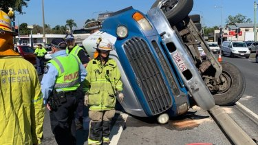 A truck rollover has caused the closure of a road at Woolloongabba as emergency services work to clear the scene.