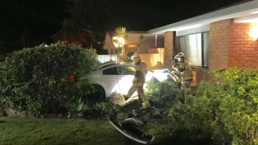 The Mooloolaba home was extensively damaged, according to police, after the car smashed into the front room.