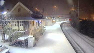 Snow blankets Katoomba train station on Tuesday morning.